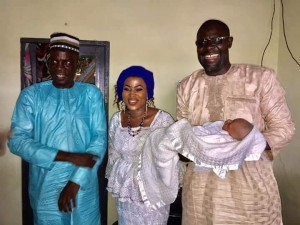 Mr. Salam holding his son  flank by Haruna Iddrisu and Mrs Salam in the middle
