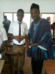 Hon Mumuni shaking hands with one of the students