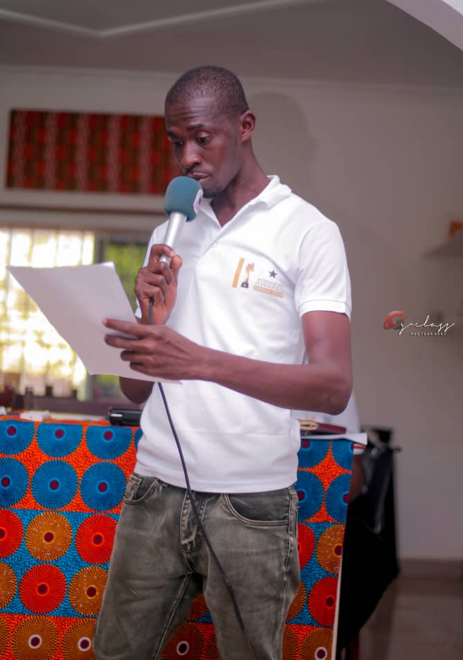 CEO of Pluz Consult, addressing the guests
